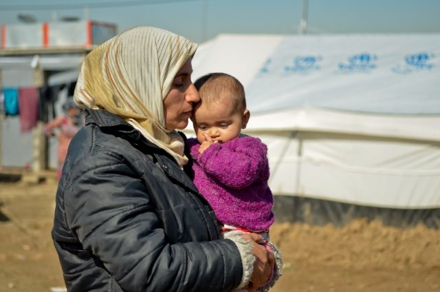 A Syrian woman and her 2 year old son in Domeez Camp, Iraq