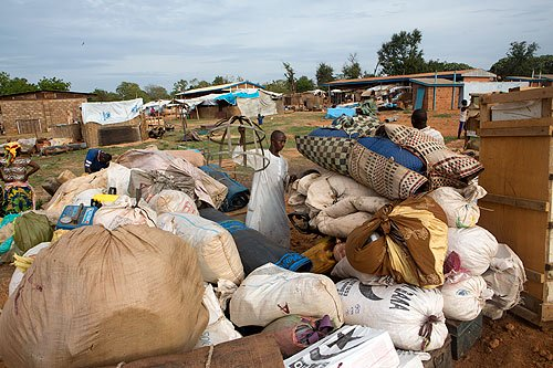 A man packs up his belongings. The remaining 540 muslims of Bossangoa left to Chad on Friday. Photo: Ton Koene