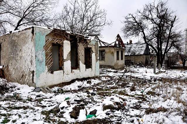 Destroyed houses in Ilovaisk, Donetsk region. Many houses and the school were heavily damaged during a big battle for the town in August 2014. Photo by: Corinne Baker