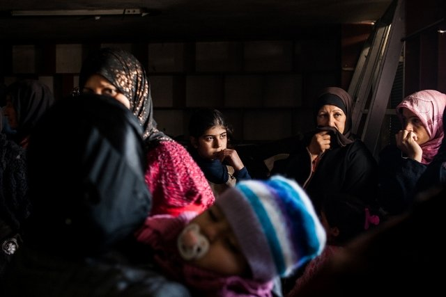 Women wait in MSF's mobile clinic to register their names to see a doctor in Northern Syria. Photo: Nicole Tung