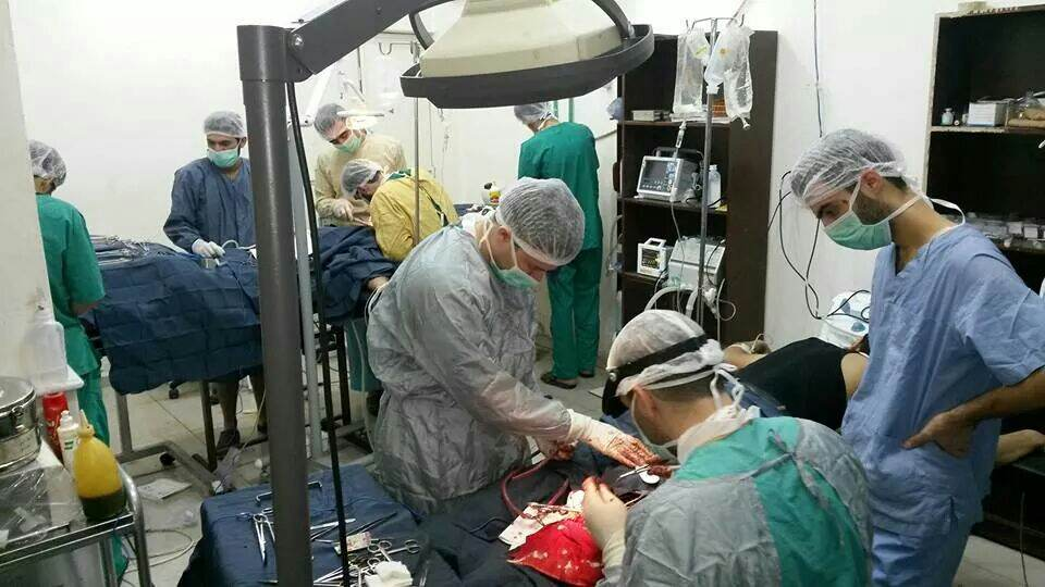 Doctors and surgeons treat the wounded in a operating theatre set up in a makeshift hospital in an east Damascus neighbourhood. Photo: MSF