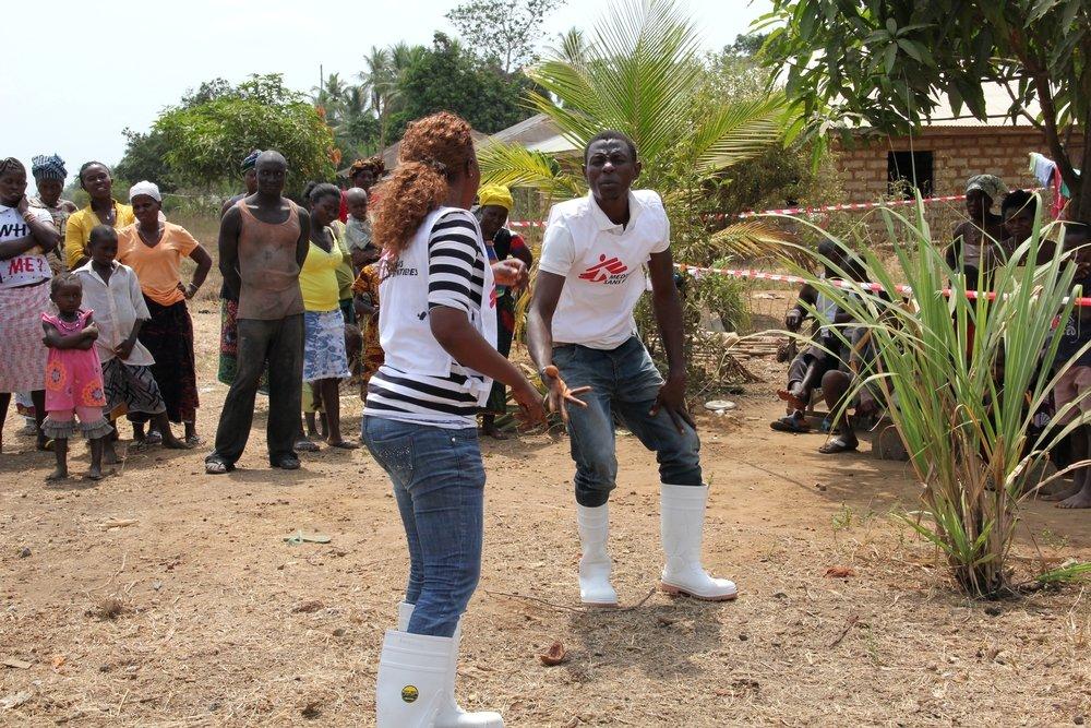 Health promotion outreach team perform a drama piece to convey Ebola key prevention messages. Photo: Sophie McNamara