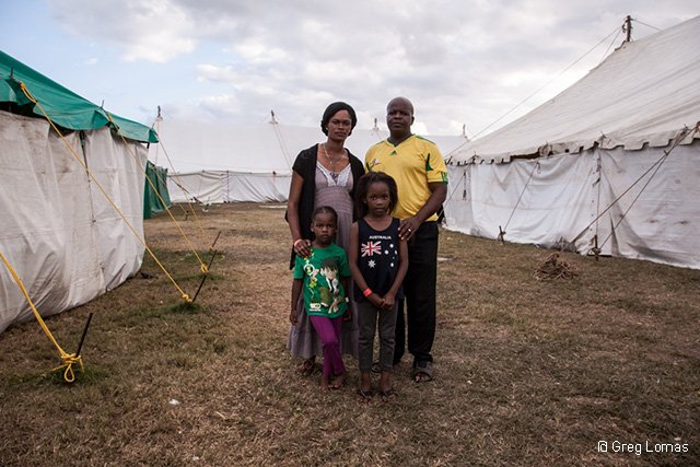 Kasai, his wife and children in the tented camp where they sought refuge from a wave of xenophobic violence that broke out in Durban.