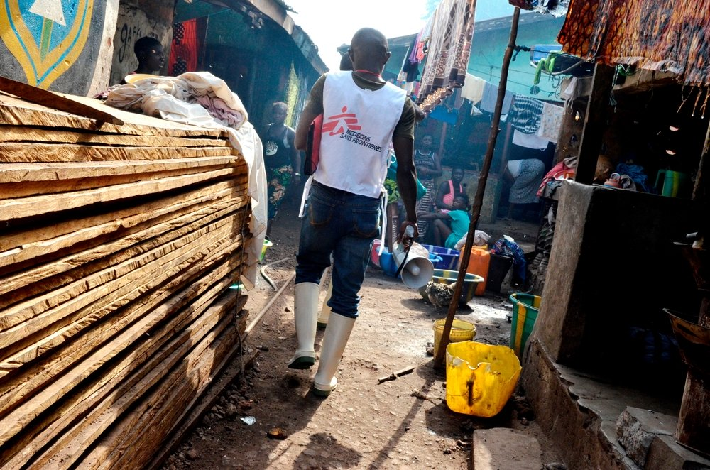 Musa, MSF's health promoter, going into the slum of Moa Warf. Photo: Alessandro Siclari