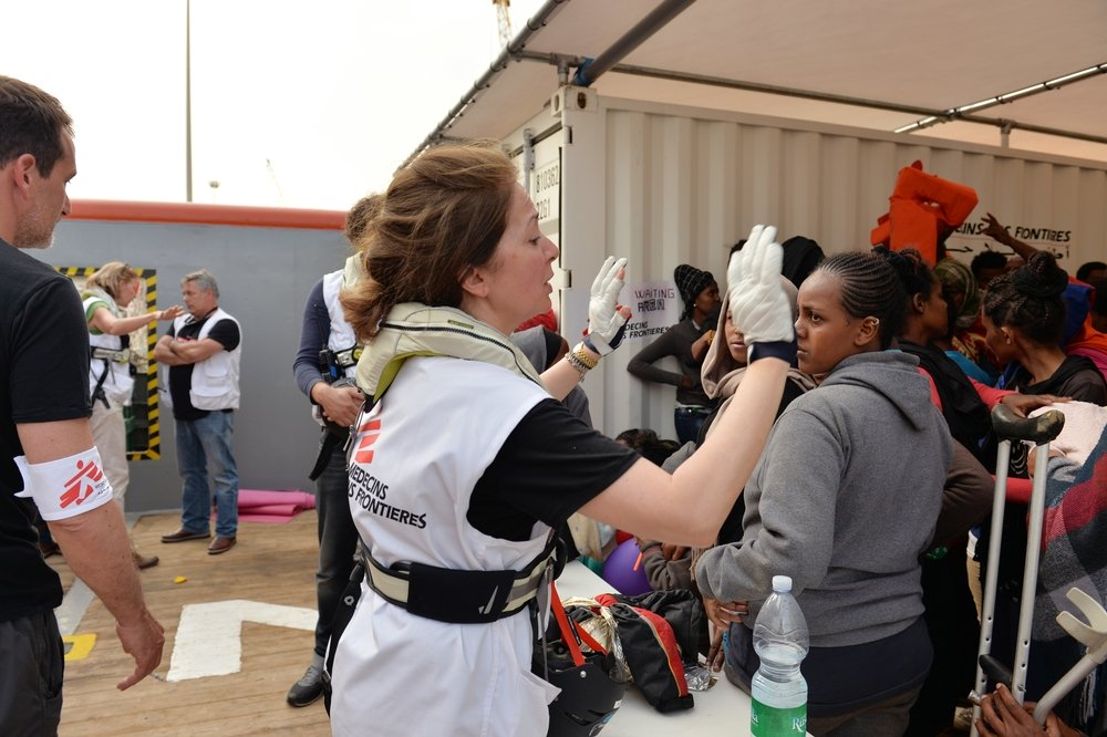 Nazek Raouf, MSF doctor  onboard the Argos asking people rescued to remain calm. Photo: Julie Remy