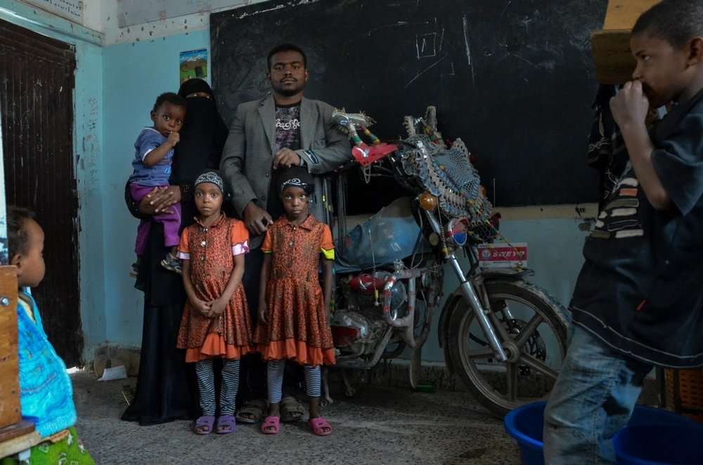 Mazen Abdu of Sa'ada, his wife and three children escaped Sa'ada on his motorbike. Photo: Malak Shaher