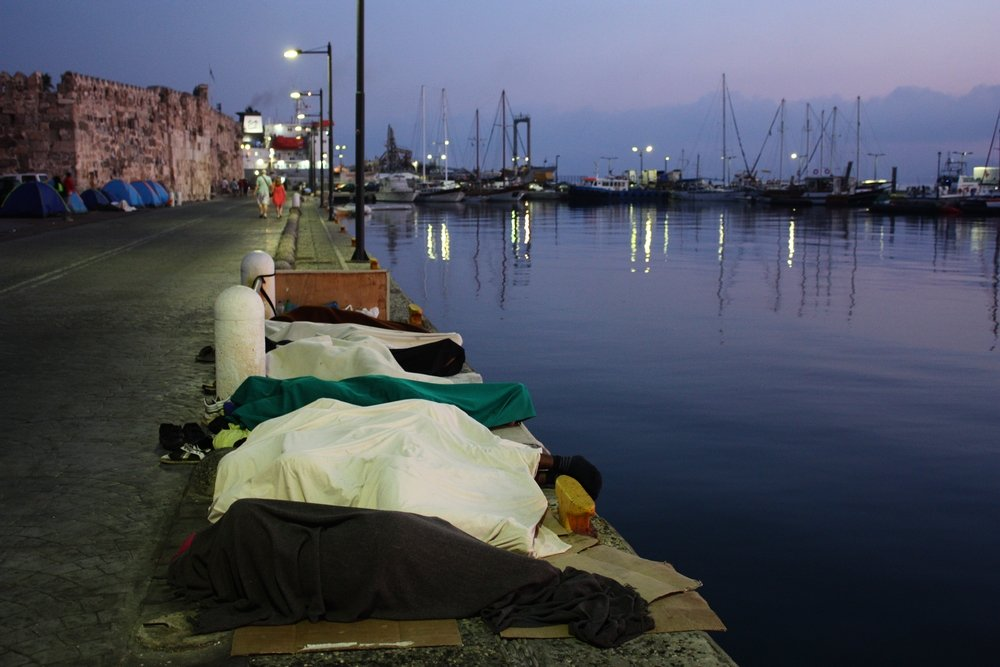 Early morning in Kos - refugees sleep rough by the port. Photo: Alva White