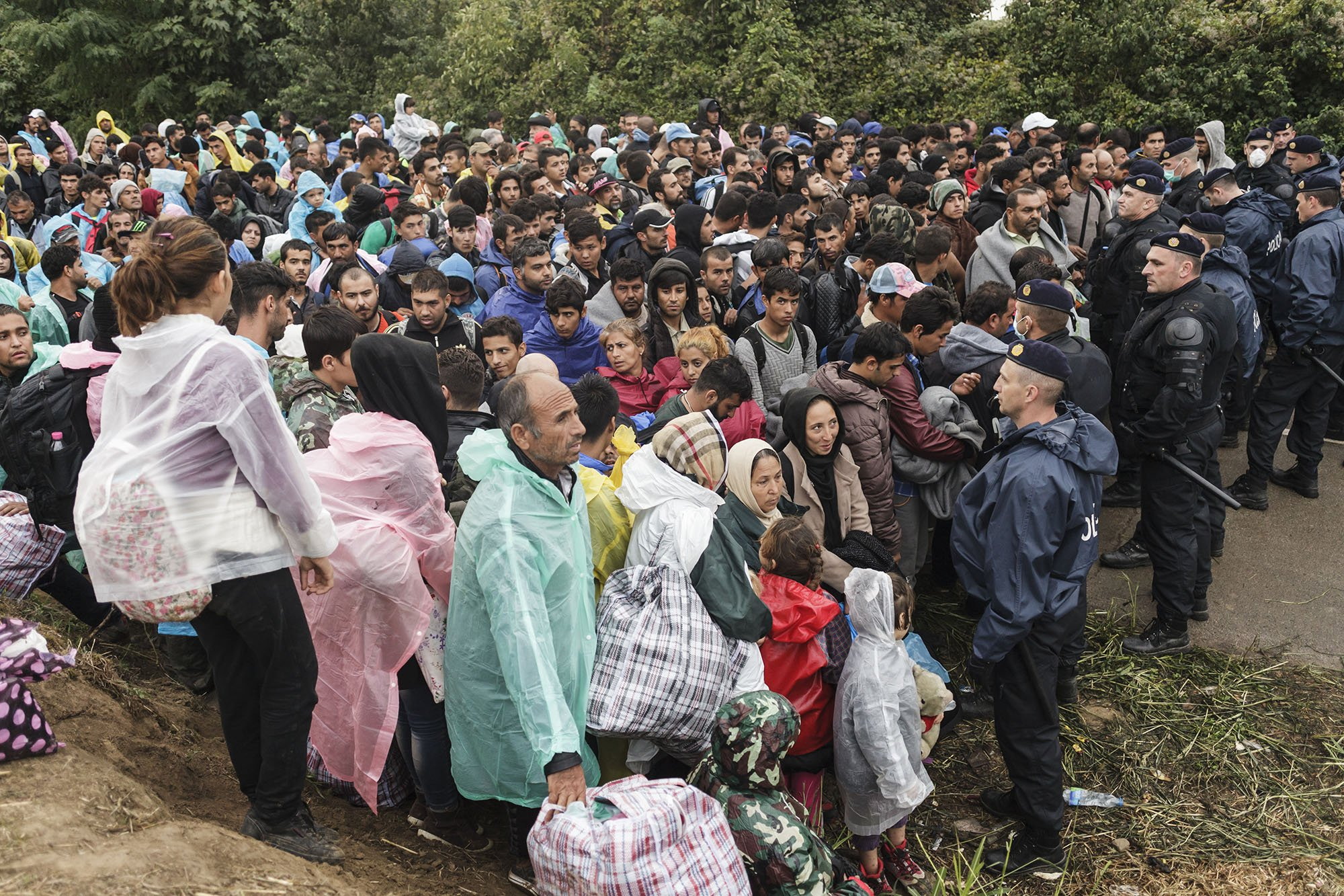 Refugees and migrants wait on the Serbian side of the Bapska border crossing, hoping to enter into Croatia. Photo: Achilleas Zavallis