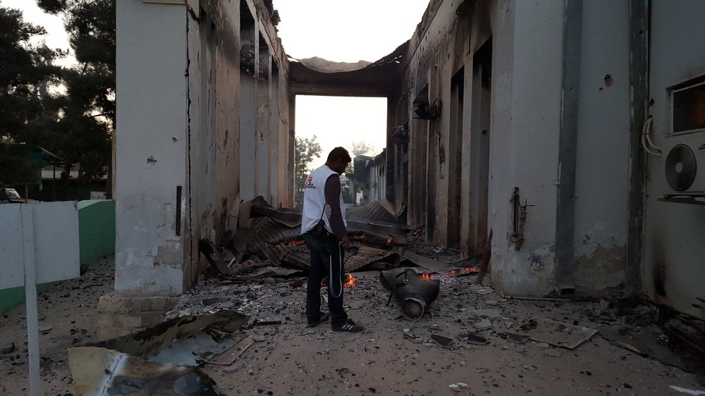 An MSF staff member walks through the grounds of the Kunduz trauma centre, 03 October, hours after it was badly damaged from sustained bombing on Saturday October 3. Photo: MSF