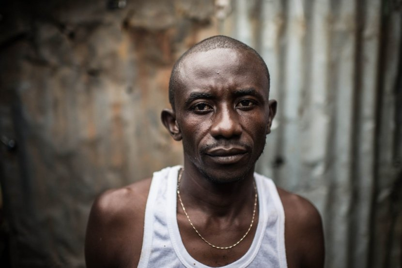 Ebola survivor Abbas Kanu photographed outside his home near the village of Lakka. Photo by: Tommy Trenchard.