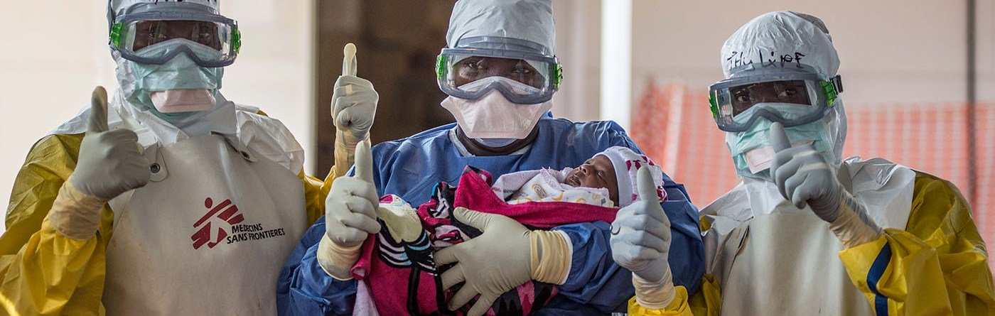 Conakry, Guinea, 11/18/2015: Baby Nubia was the last Ebola patient in Guinea. Here it is supported by our team of the treatment center to her uncle Adama. Photo: Tommy Trenchard