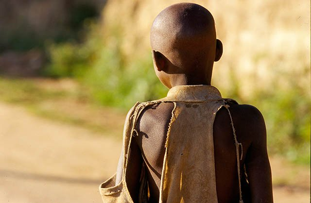 Portrait of child's back in Camp Rukondo. On 6 April 1994, the Rwandan and Burundian presidents were killed in the plane that that was heading to Kigali . The next day the massacres began. Photo: Severine Blanchet