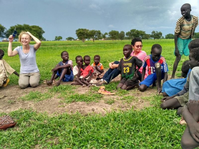 Carissa having a light-hearted session with young South Sudanese kids