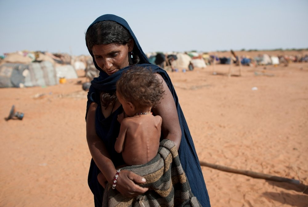 Malian refugees who arrived recently to the Mbera refugee camp live in makeshift shelters in neighboring Mauritania