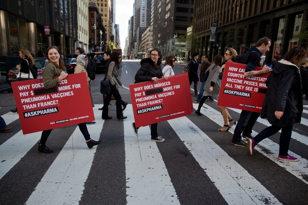 Activists from Doctors Without Borders protest vaccine pricing policies in front of the Pfizer World Headquarters in New York