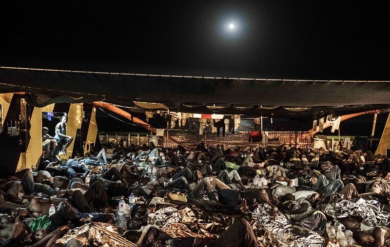 533 people sleep on the deck of the Borbon Argos after being rescued at sea by MSF in the Mediterranean.
