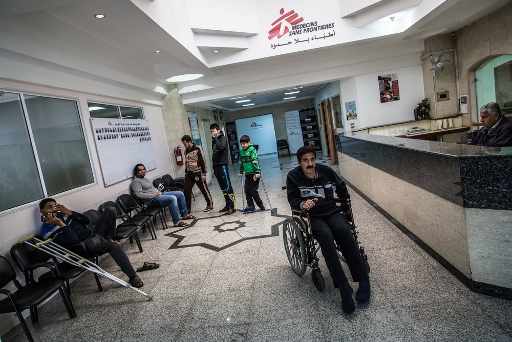 MSF hospital entrance. Early in the morning, the hospital patients move around freely