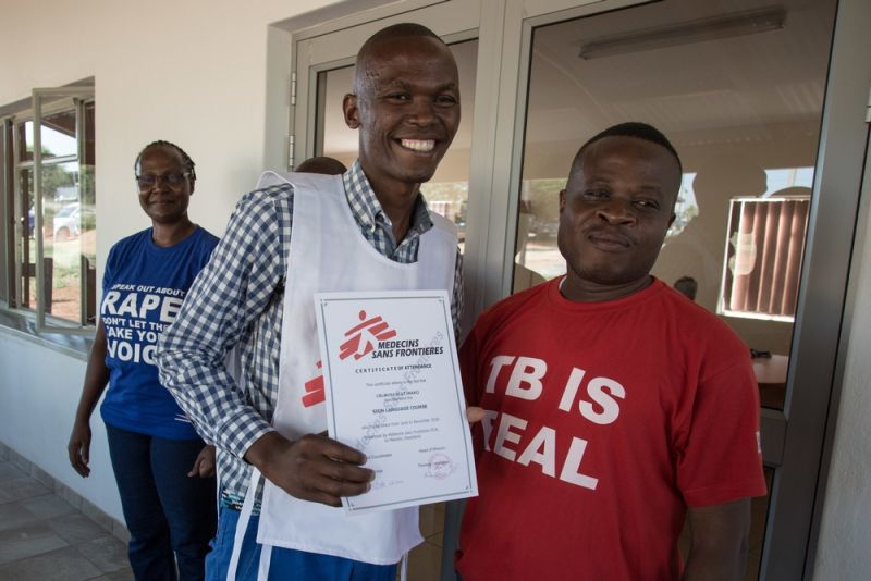 MSF mobile counsellor Celumusa Hlatswako stands with Dr. Emmanuel Masombuko, MSF Medical Team Leader in Swaziland