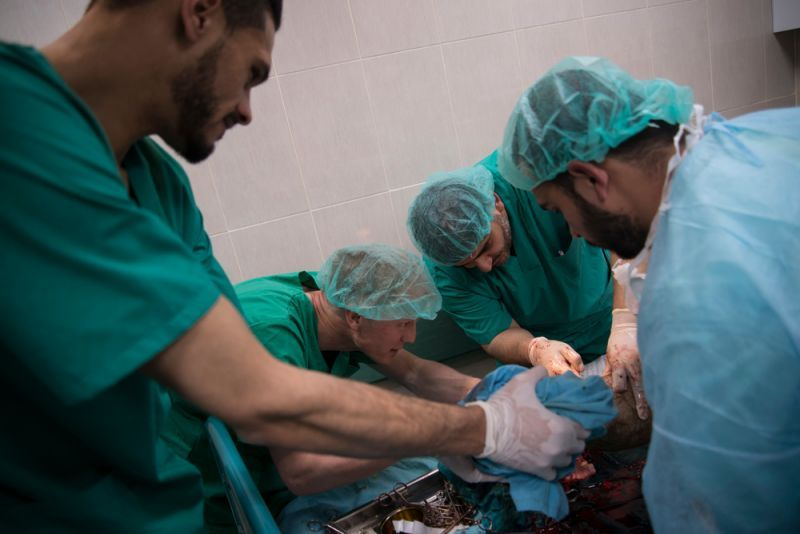 MSF team is conducting an assessment on a patient before surgery