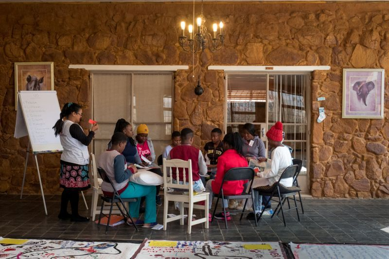 A sexual assault survivor working on her body map during MSF's Body Mapping workshop, Rustenburg