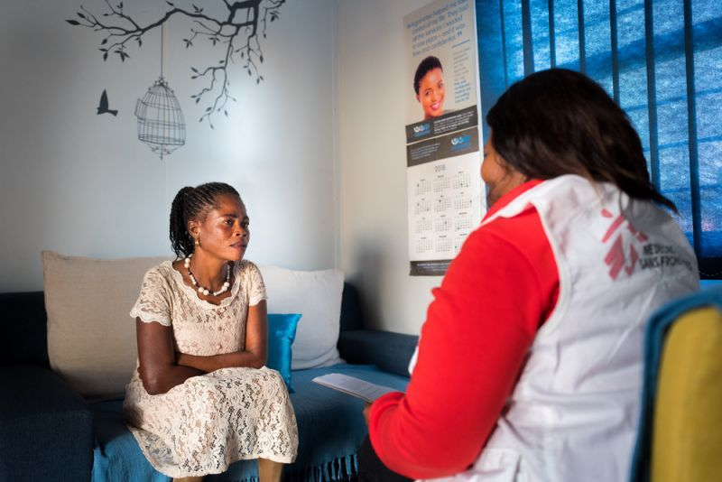 An MSF social worker talks with Rosina Seela Moole, survivor of sexual violence at te BKCC MSF clinic in Rustenburg