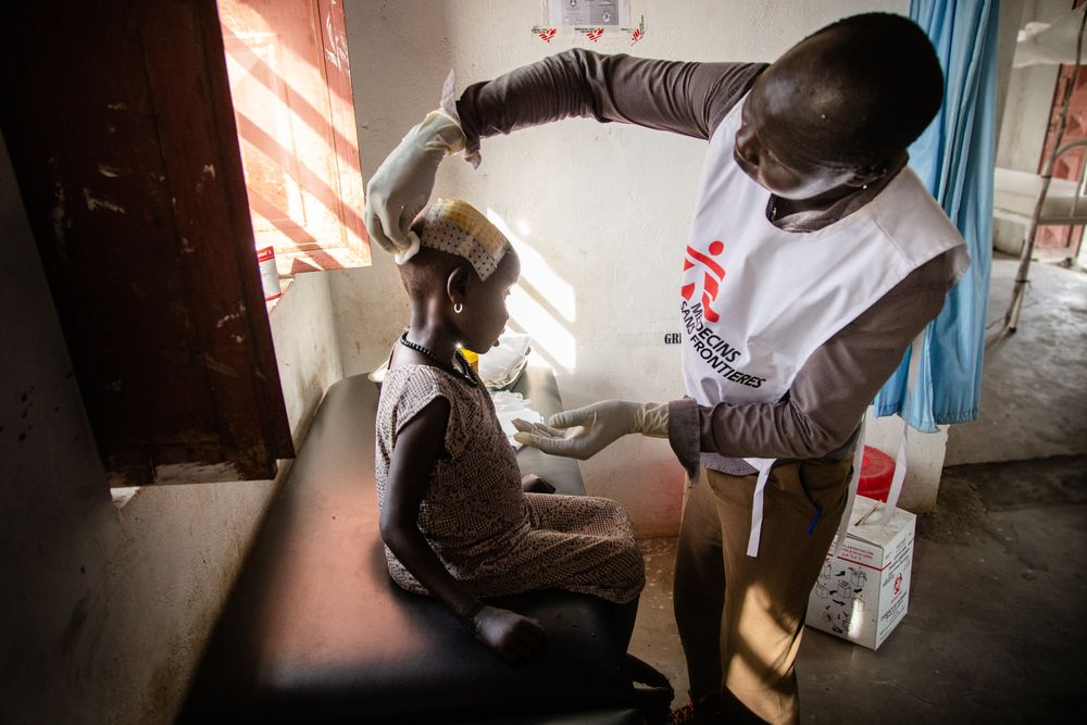 MSF consulting with a child in South Sudan