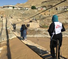 MSF Medical Team crossing the Kyan Abad rope bridge to deploy a mobile clinic in Paran Parvis village on the ride side of Kashkan River in Iran