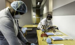 A picture of health workers preparing health promotion items in South Africa