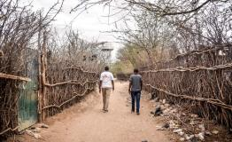 MSF Staff walking through one of the streets in Dagahaley camp, Dadaab