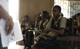 Health workers addressing school children about mental health in Liberia