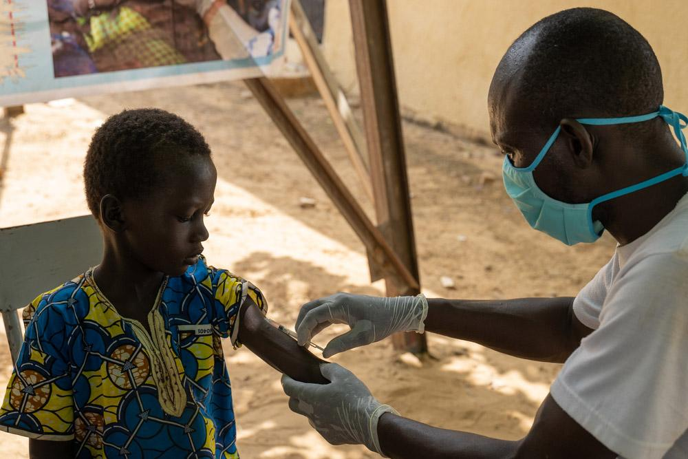 Child getting vaccinated in Mali by our MSF staff