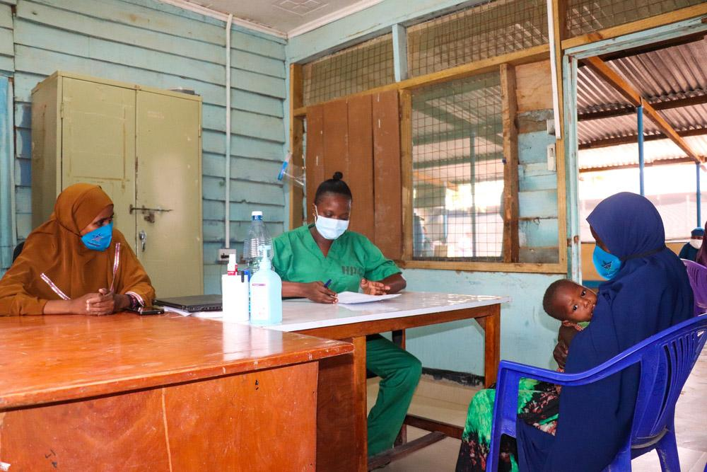 Health workers giving a consultation