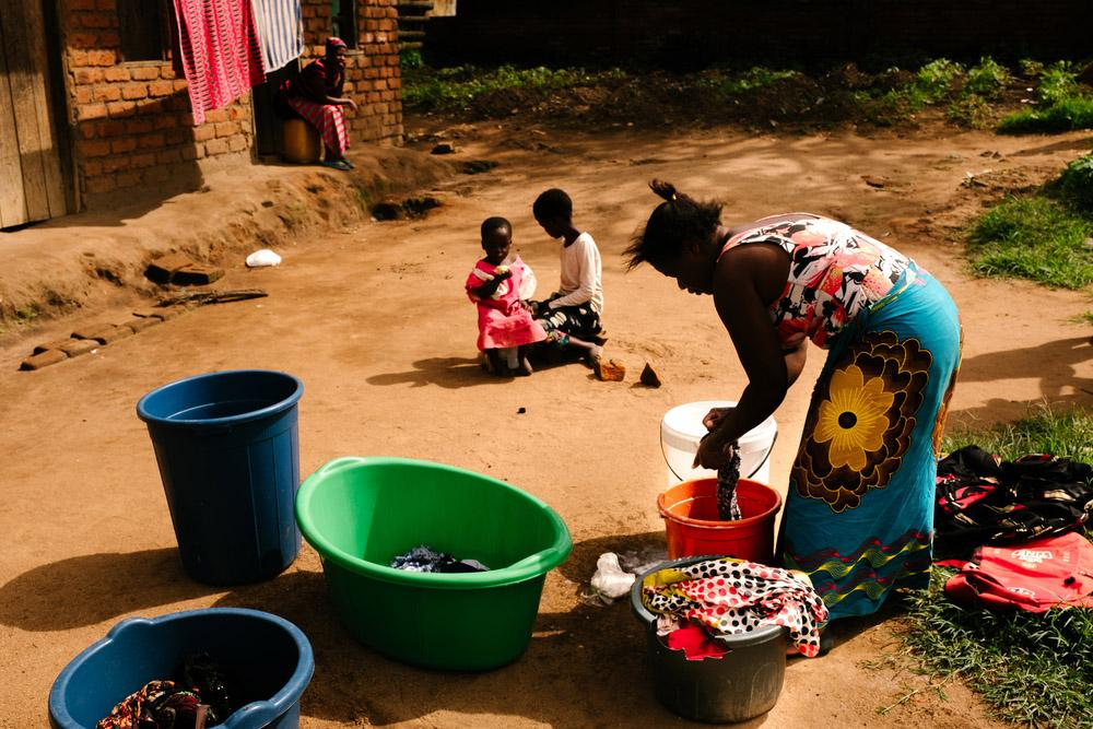 A picture of a woman washing clothes in Malawi