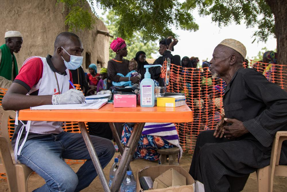 A picture of an elderly man receiving a consultation at MSF's medical facility in central Mali, where people fled in search of refuge because of deadly attacks on villages.