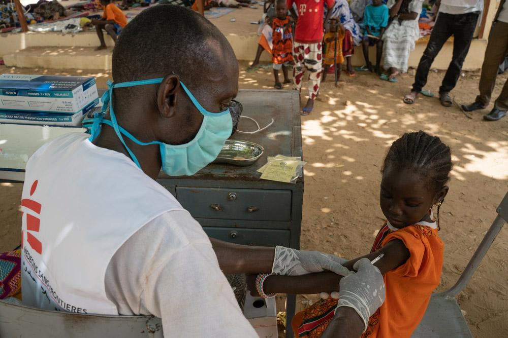 Child being vaccinated against measles in Mali