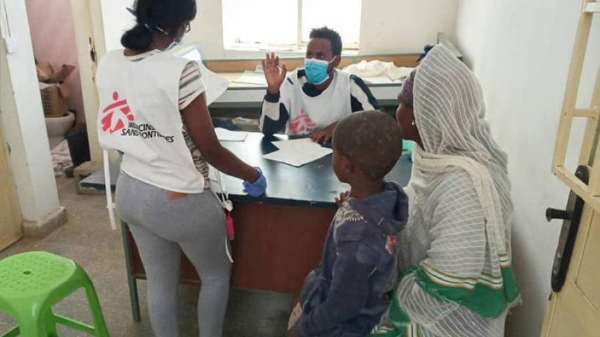 An MSF nurse and a translator prepare a donation of medical materials in Megab,