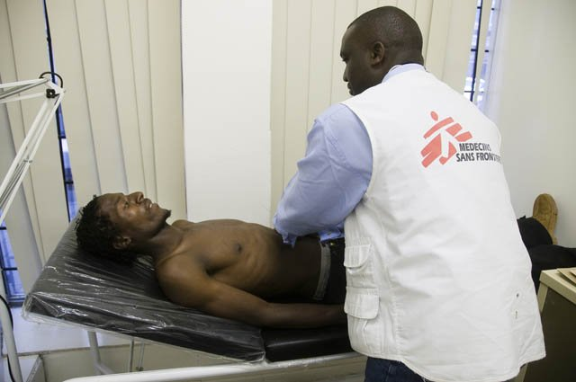 South Africa: MSF doctor examining a Zimbabwean refugee